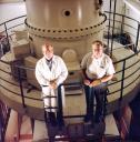 Dick McIntosh and George Wray pose on the upper deck of the JEOL 1000C TEM